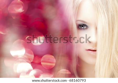 The image of a beautiful girl and a bright light - stock photo