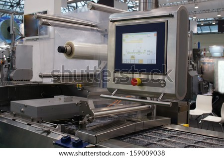The image of a food packing industry equipment - stock photo