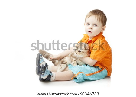 The image of a little boy with a cat on a white background