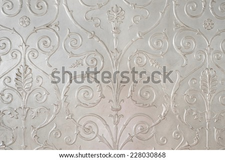 the image of a structural pattern on the wall