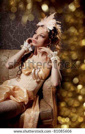 The image of a woman in a luxurious vintage-style - stock photo