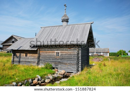 The image of a wooden church - stock photo