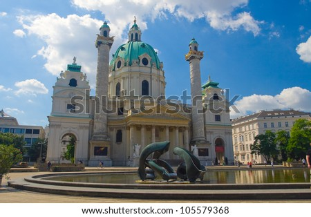 The image of an ancient building in the middle of the yard which is a fountain in the form of statues. Vienna, Austria. - stock photo