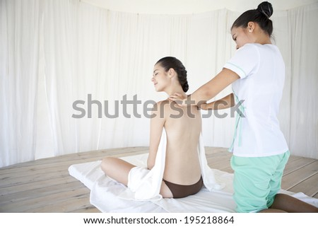 the image of an Asian woman getting a massage