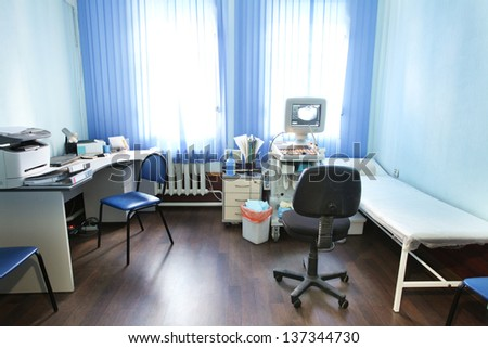 The image of an empty doctor's consulting room - stock photo