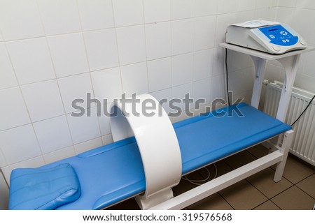 The image of an empty treatment room. Magnetic therapy device - stock photo
