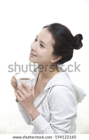 the image of Asian woman drinking coffee