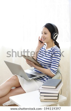 the image of Asian woman on laptop