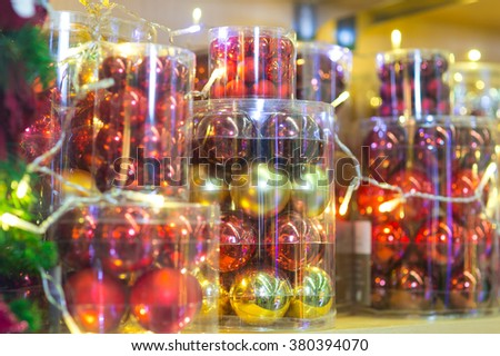 The image of Christmas balls in the boxes