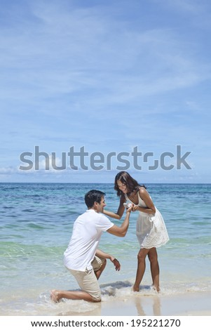 the image of couple hugging by the sea in Boracay in the Philippines