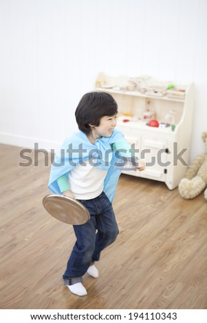 the image of cute Asian boy playing