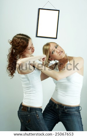 The image of fight of two girls because of the man isolated - stock photo