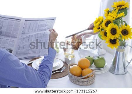 the image of flowers and breakfast table