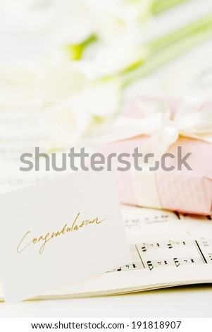 The image of gift box and congratulations note