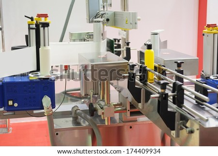 The image of industrial labeling equipment  - stock photo