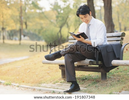 The image of Korean business man with note book
