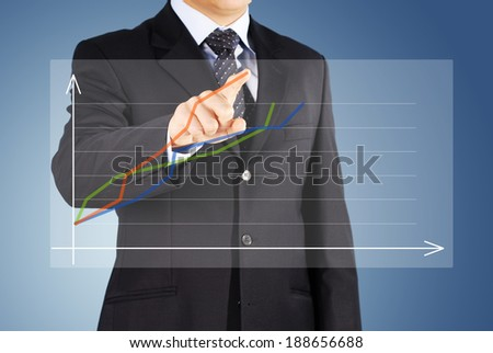 the Image of male hand pointing at business graphics - stock photo