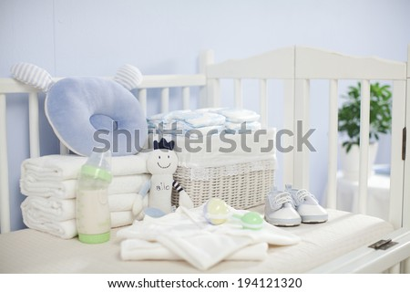 the image of parenting and baby boy clothes - stock photo