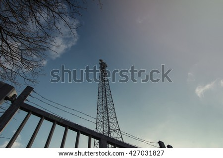 The image of phone tower in a small village