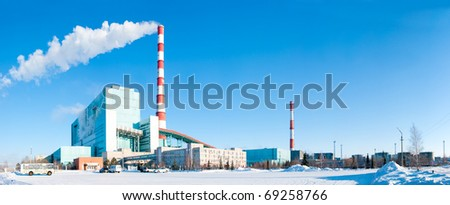 The image of power station against a winter landscape - stock photo