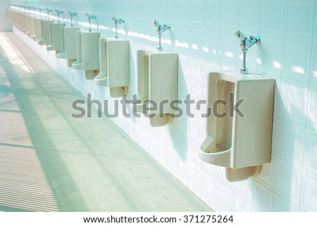 The image of public men toilet. - stock photo