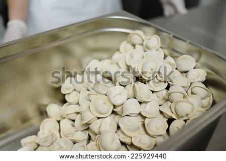 The image of raw pelmeny - stock photo