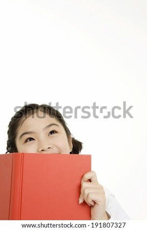 The image of smiling Korean girl with red book