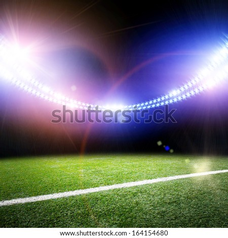 The image of stadium in lights and flashes - stock photo