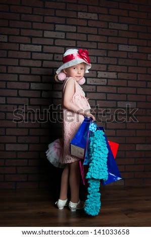 The image of the elegant girl with purchases - stock photo