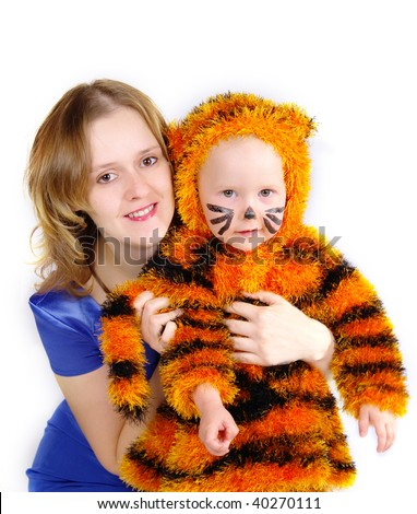 The image of the elegant woman and the girl in a suit of a tiger - stock photo