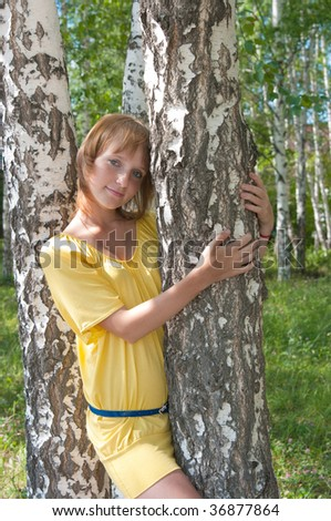 The image of the girl embracing a birch
