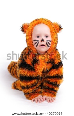 The image of the girl in a suit of a tiger - stock photo