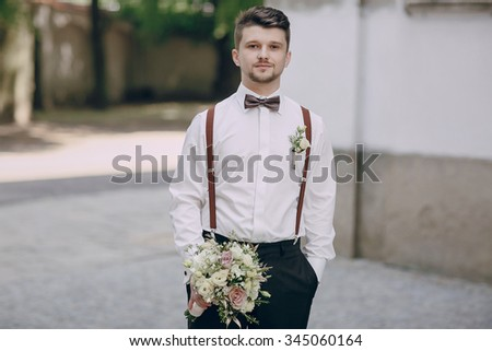 the image of the groom shirt and suspenders wedding bouquet - stock photo