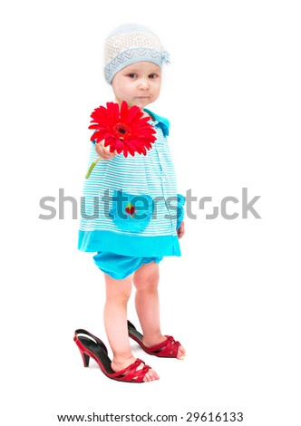 The image of the little girl with a flower on a white background. A flower not in focus