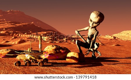 The image of the Martian and mars rover - stock photo