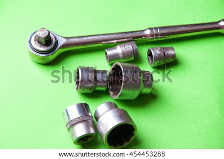 The image of tools on a green background.