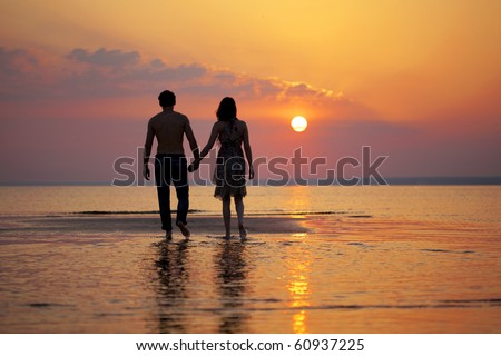 The image of two people in love at sunset