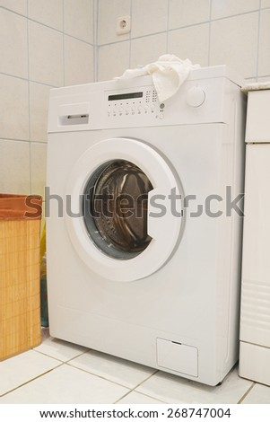 The image of washing machine at the bathroom  - stock photo
