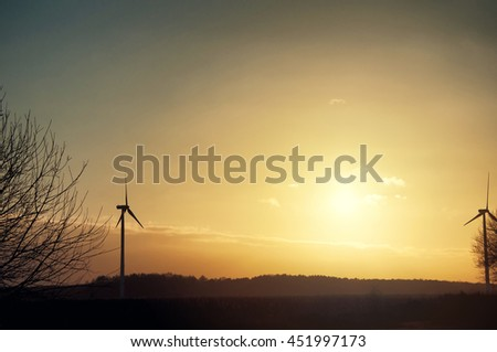 The image of windmill, sunset, energy