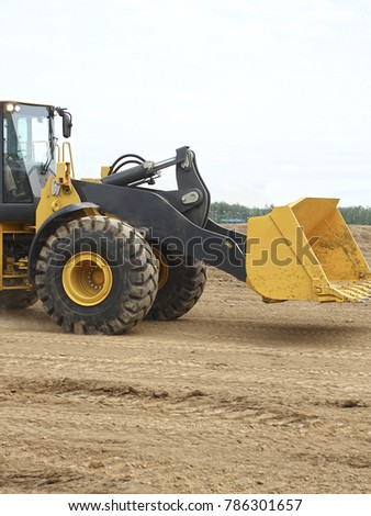 The image of working tractor