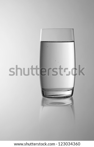 The image shows a glass filled with fresh water