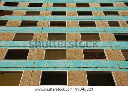 the image shows a tower building ready for demolishing - stock photo
