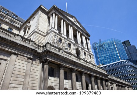 The impressive facade of the Bank of England located in the City of London. - stock photo