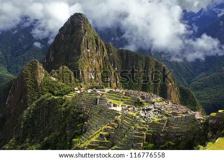 The Incan ruins of Machu Picchu in Peru - stock photo
