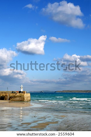 The incoming tide at St. Ives, Cornwall. - stock photo