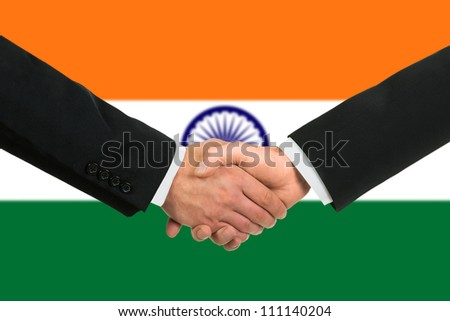 The Indian flag and business handshake - stock photo