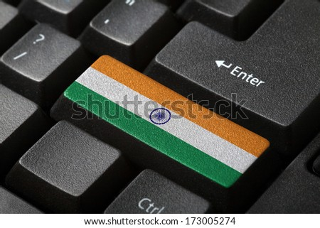 The Indian flag button on the keyboard. close-up - stock photo