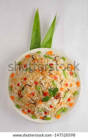 The Indian Pulav- It is a medley of rice, vegetables and/or meat. The rice is browned in oil and then mixed with vegetables, egg, chicken , nuts, fruits etc. Basmati Rice is generally used for making  - stock photo