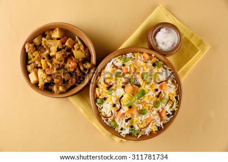 The Indian Pulav vegetables and The rice is browned in oil and then mixed with vegetables nuts, fruits etc. Basmati Rice,Vegetable Rice - stock photo