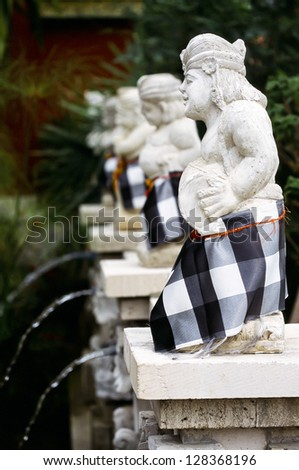 "The Indonesian statue in skirts ""SARONG"""